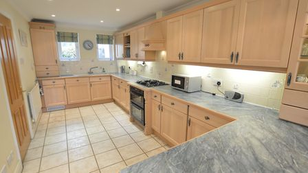 The kitchen is fitted with a quality range of cabinets