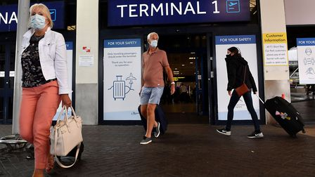 Passengers wearing a face mask at Manchester Airport in Manchester. Photo: Anthony Devlin