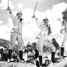 Douglas Fairbanks Jr. as Sergeant Thomas Ballantine, Cary Grant as Sergeant Archibald Cutter, and Vi