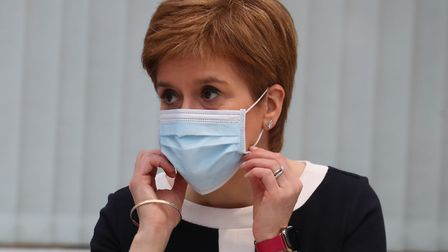 Scotland's First Minister Nicola Sturgeon wears a face mask during her visit to the field hospital t