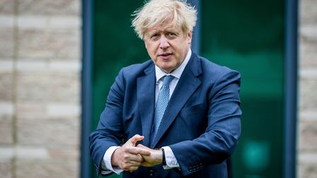 Prime minister Boris Johnson using antiseptic hand gel during a visit to North Yorkshire Police head