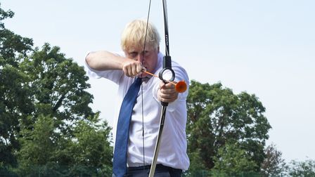 Prime Minister Boris Johnson takes part in archery during a visit to the Premier Education Summer Ca