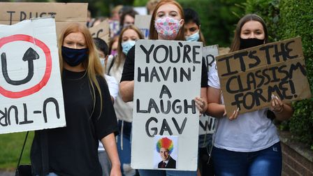 Students from Codsall Community High School march to the constituency office of their local MP Gavin Williamson, who is...