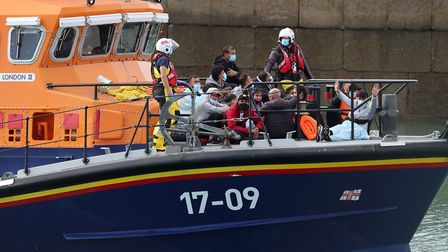 A group of people thought to be migrants are brought into Dover, Kent, onboard the Dover RNLI lifebo