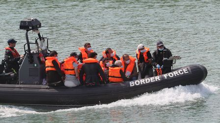 A group of people thought to be migrants are brought into Dover, Kent, by Border Force officers. Pho