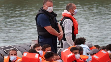 A group of people thought to be migrants are brought into Dover, Kent, following a number of small b