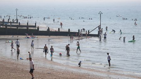 People take to the sea as they enjoy the hot weather on Hayling Island beach in Hampshire. Picture: