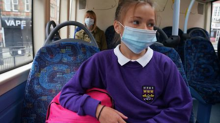 A school pupil wearing a face mask. Pupils wearing masks is an option that should be kept under revi