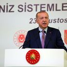 Turkish President Recep Tayyip Erdogan makes a speech as he attends the delivery ceremony of New Nav
