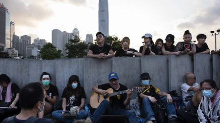 Protesters gather near Hong Kong's Legislative Council Complex singing encouraging songs to support