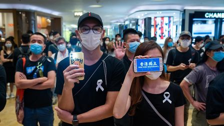 A female protester displays a Hong Kong independence message on her mobile phone during a demonstrat