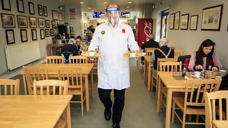 Liberal Democrat leader Ed Davey undertakes a 'shift' in Taylor's chip shop, in Stockport, during th