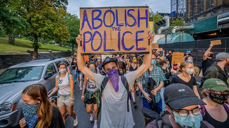 A participant holding a Abolish Police sign at a protest in New York City. Photo: Erik McGregor/Ligh