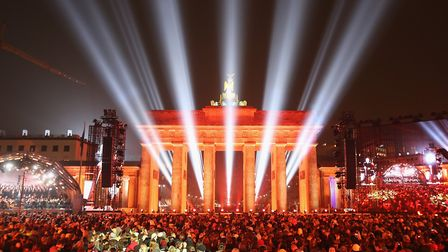 The Brandenburg Gate illuminated during celebrations on the 25th anniversary of the fall of the Berl