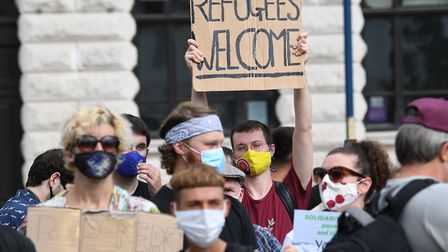 Pro-migrant supporters during a 'solidarity stand' in Dover's Market Square in support of the refuge