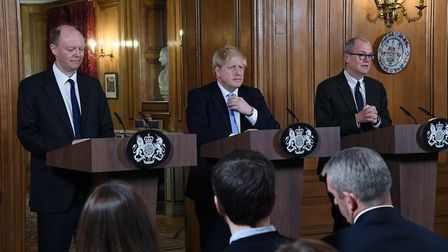 Prime Minister Boris Johnson, alongside Chief Medical Officer for England Chris Whitty (left) and Ch