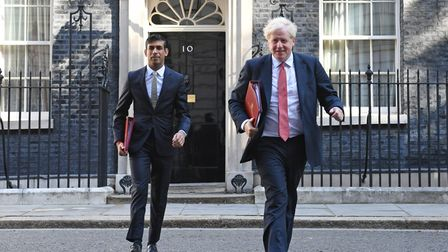 Chancellor of the Exchequer Rishi Sunak (left) and Prime Minister Boris Johnson leave 10 Downing Street. Photograph...