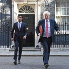 Chancellor of the Exchequer Rishi Sunak (left) and Prime Minister Boris Johnson leave 10 Downing Street. Photograph: Stefan R...