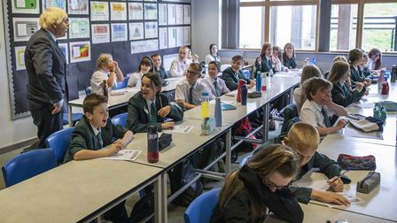 Prime Minister Boris Johnson visiting a year 7 class on their first day in school as he tours Castle