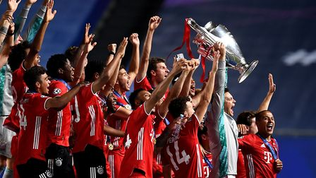 Manuel Neuer, captain of FC Bayern Munich lifts the UEFA Champions League Trophy following his team'