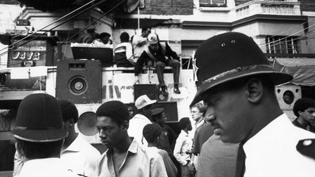 Police in front of a sound system, Notting Hill Carnival, 1983. Photo: PYMCA/Universal Images Group