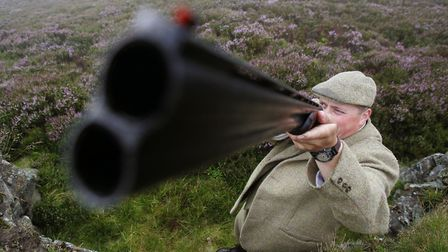 Gamekeeper Gavin Hannan in a butt on the grouse moor at the Glen Lethnot estate in the Angus Glens n