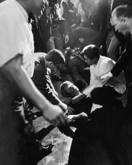 Senator Robert F. Kennedy lies on the floor of the Ambassador Hotel after being shot by a young Jord