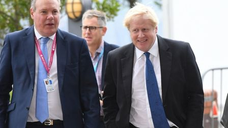 Conor Burns (L) arrives at the Conservative Party annual conference in 2018 alongside then foreign minister Boris Johnson