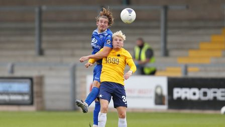 Ben Whitfield of Torquay United battles for the ball during the pre-season friendly against Chippenham Town at Plainmoor.