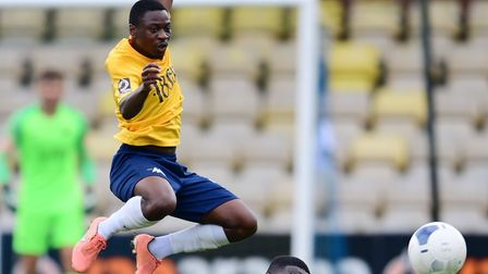 Aaron Nemane of Torquay united leaps a challenge by rival player