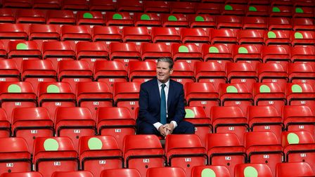 Labour Leader Keir Starmer sits in social distanced seating during a visit of Walsall Football Club