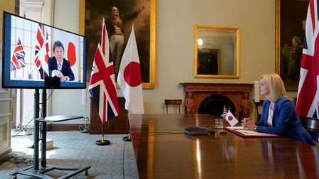 Liz Truss speaking to Japan's Minister for Foreign Affairs Toshimitsu Motegi