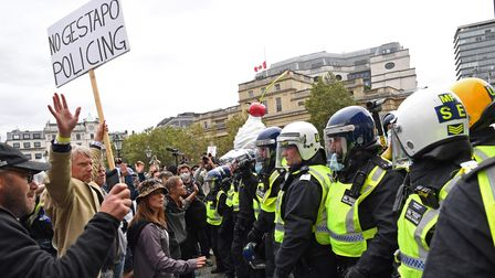 Protesters and police at a 'We Do Not Consent' rally at Trafalgar Square in London, organised by Sto