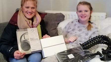 Brave Tiana - who underwent surgery to remove a quarter of her brain - recieves an iPad and accessor