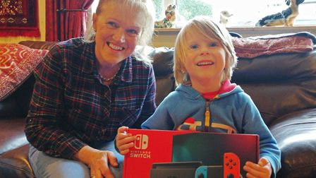 Torbay Bikers for Kids' Sue Kray presented Noah with a Nintendo Switch