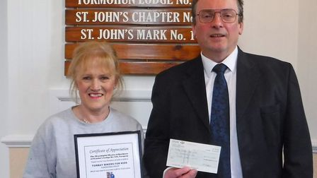 The Worshipful Master of St John�s Lodge No 328, Torquay, presented Sue Kray with a donation which w