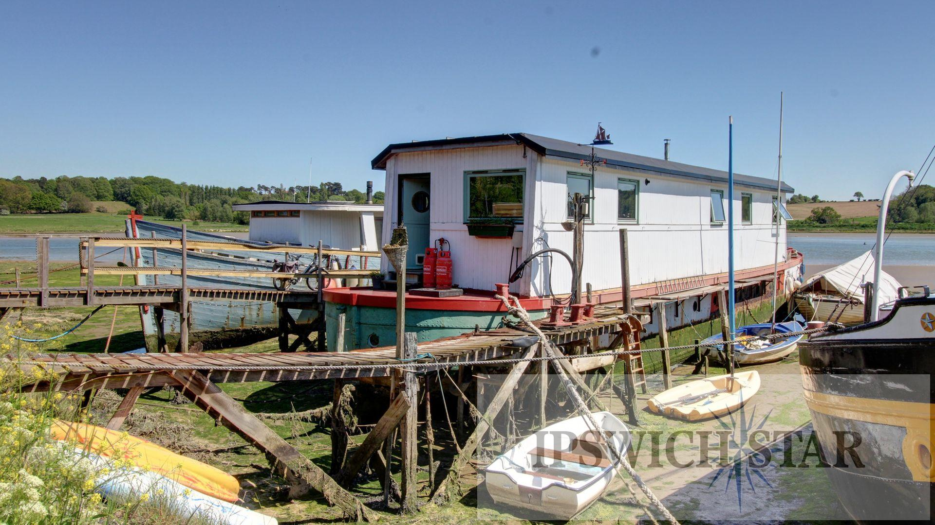 Inside quirky off-grid houseboat with stunning river views - yours for £500k