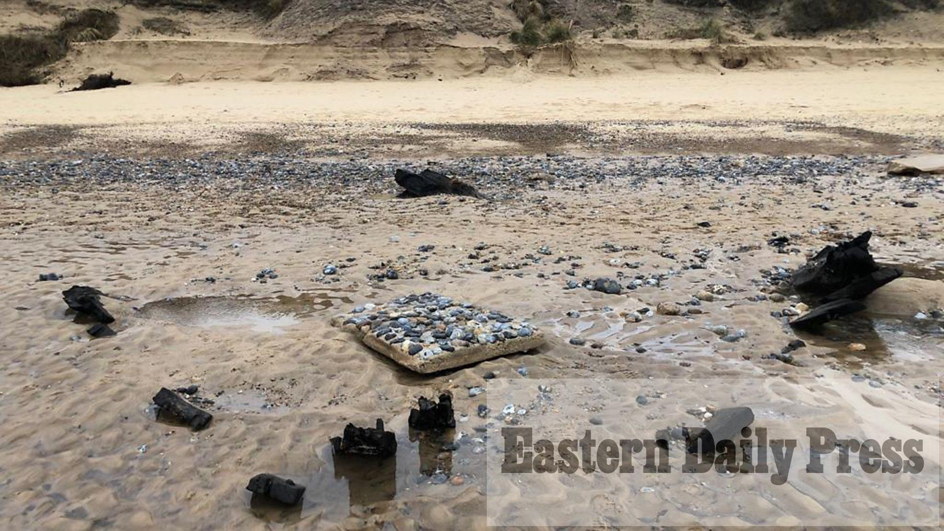 Shipwreck exposed by erosion on Norfolk beach